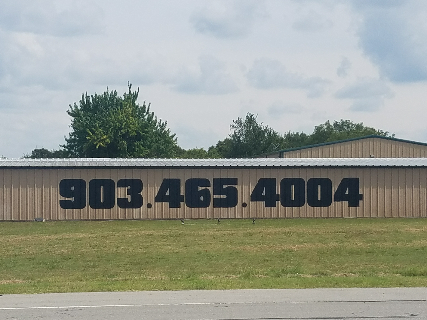 Phone number painted on the building